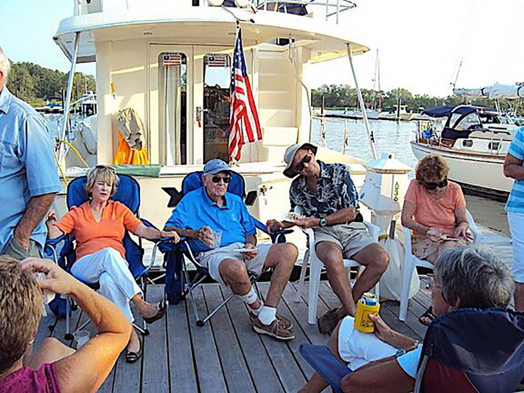 HYC Power Cruisers enjoying the camaraderie at a dock party